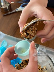 Packing One Side of Birdseed Egg
